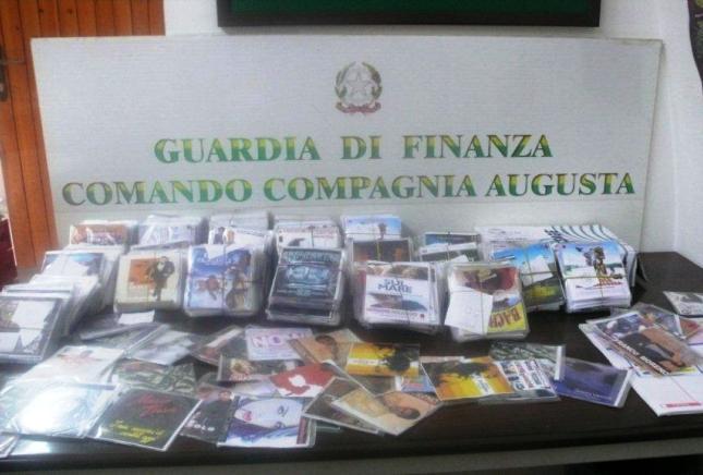 LE FIAMME GIALLE MEGARESI SEQUESTRANO UN TOTALE DI 2.500 CD E DVD ILLECITAMENTE RIPRODOTTI