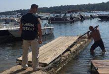 Augusta| Rimosso pontile abusivo a Brucoli con supervisione dalla Guardia costiera.