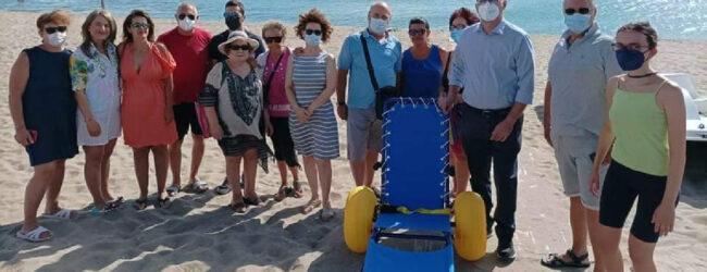 Agnone Bagni | Carrozzina job da mare per disabili al villaggio Settebello